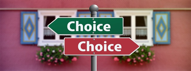 sign posts infront of a house pointing in different directions saying 'choice'