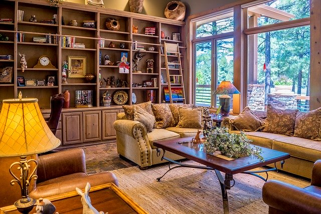 living room with large bookshelf full of ornaments and books