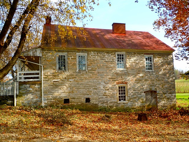stone house with autumn leaves
